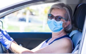Senior woman with a COVID mask PartnerMD Image