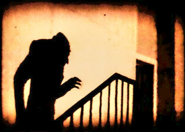 Iconic scary shadow scene from early horror film 'Nosferatu'