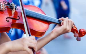 Violins being played Image