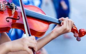 Violins being played Image