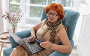 Woman doing some online shopping that gets her into debt Image