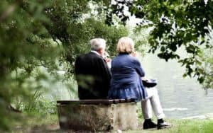 older couple gazing at lake can enjoy boomer retirement preparation Image