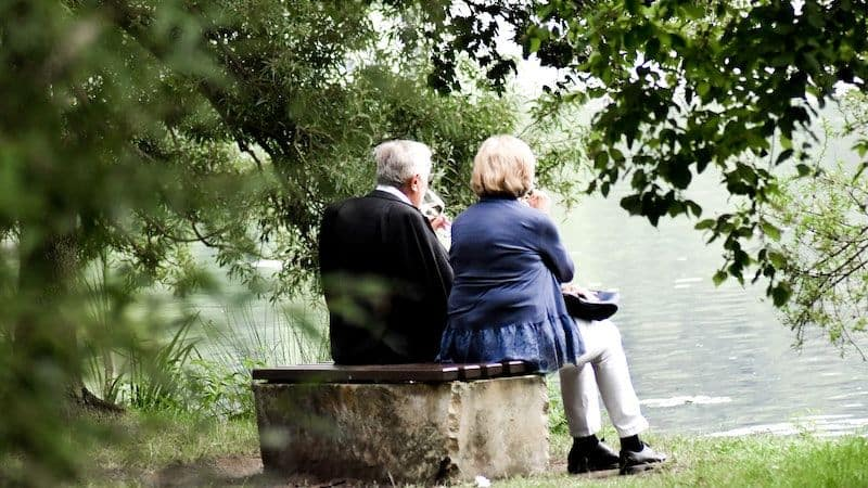 older couple gazing at lake can enjoy boomer retirement preparation Image
