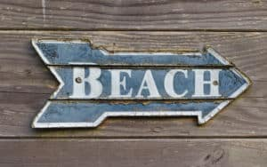 Sign pointing to the beach summons childhood beach memories Image