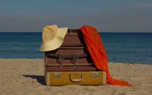 Vintage suitcases on a beach Image