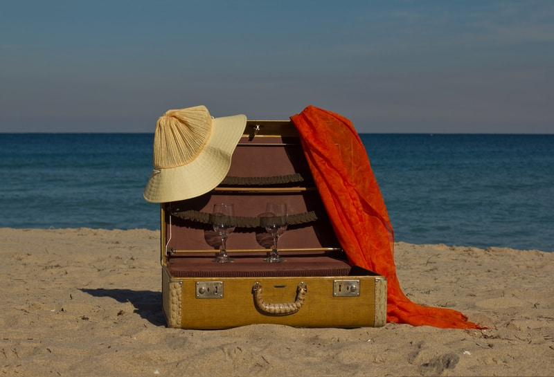 Vintage suitcases on a beach