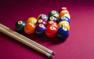 pool table and family memories, cue stick and balls Image