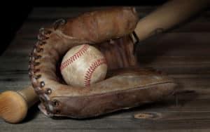Vintage baseball and bat representing the history of baseball and ballparks in Richmond, Virginia Image