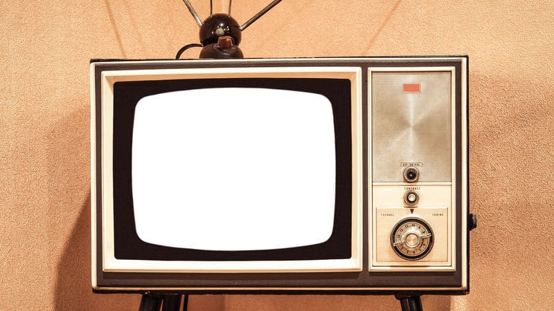 Vintage TV with rabbit ears to promote 10 ad jingles of the 1970s Image