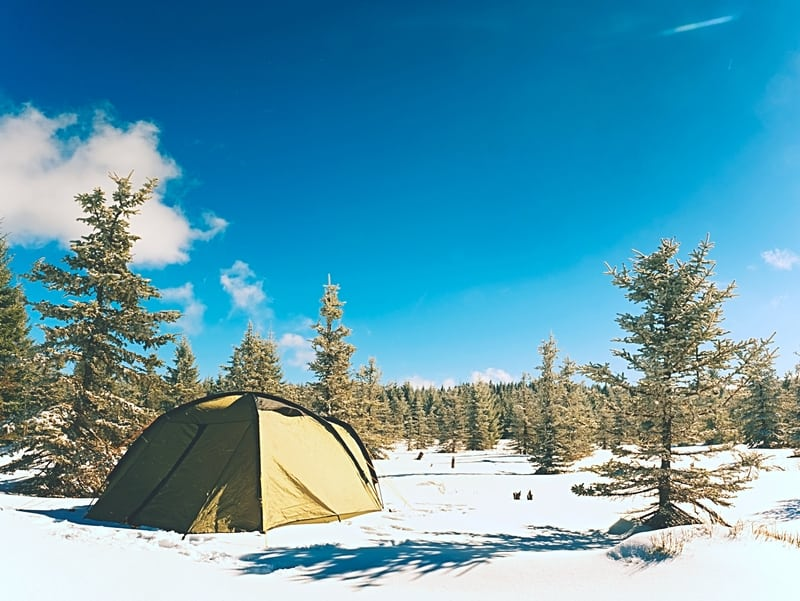 Cold weather camping with snow and tent