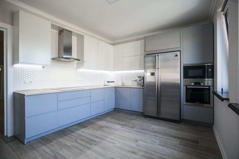 Kitchen with newly painted cabinets, an inexpensive home improvement