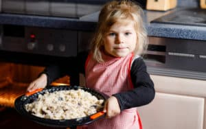 Little girl baking pies Image