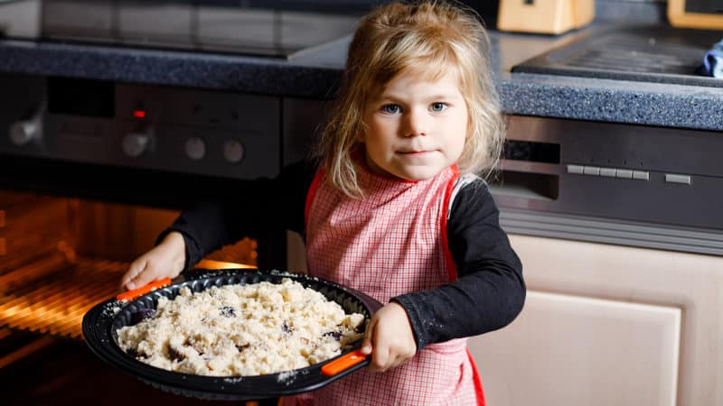 Little girl baking pies Image