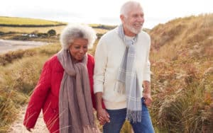 Two seniors walking in the winter health Image