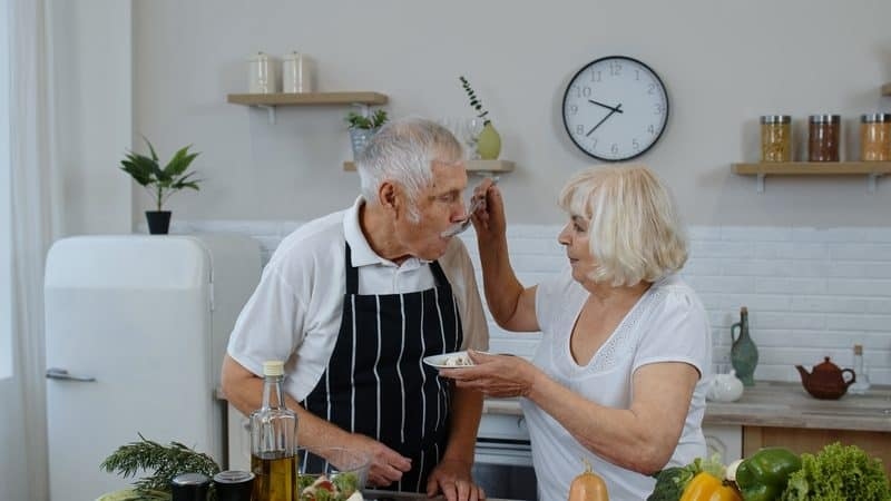 Two seniors eating food for weight loss Image