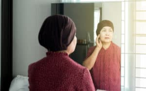 Senior woman receiving cancer treatment Image