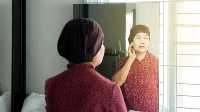 Senior woman receiving cancer treatment Image