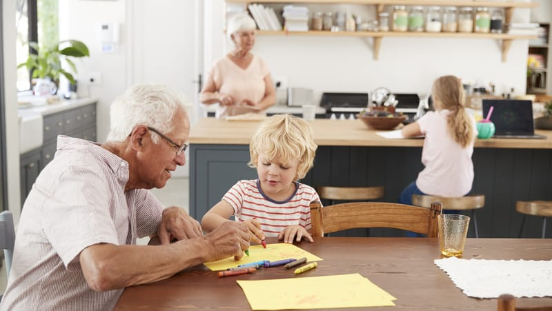 Seniors with grandkids in kitchen for