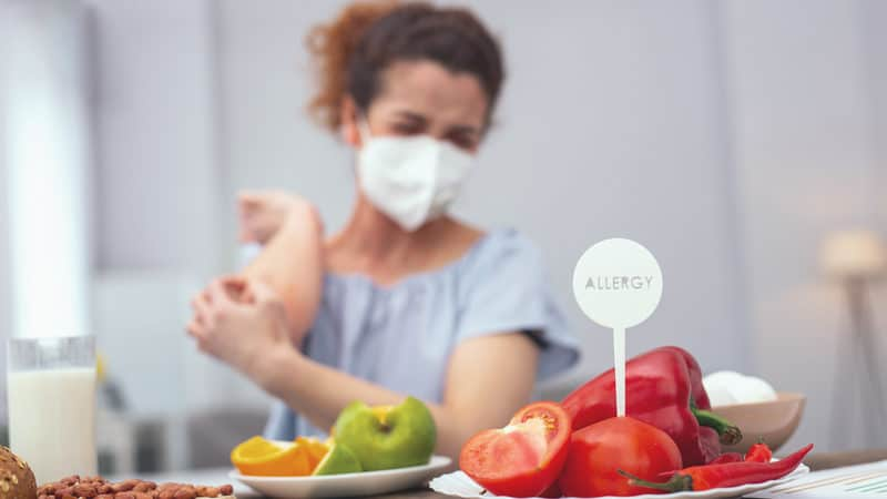 Woman with allergies at a dinner party Image