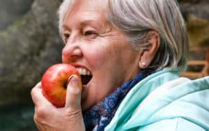 One of the healthiest people eating an apple Image