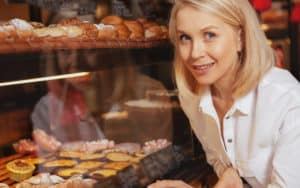 Woman at the bakery in front of bread Image