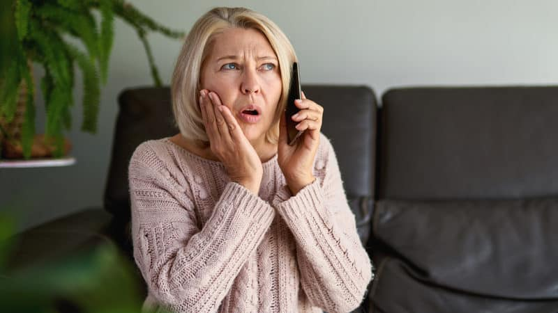Senior woman expresses her COVID concerns over the phone Image