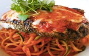Healthy grilled chicken parmesan over spiral zucchini and whole wheat spaghetti, from Hilton Head Health Image