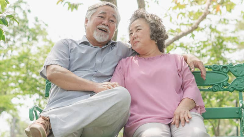 Senior couple sitting on a bench before breakfast Image