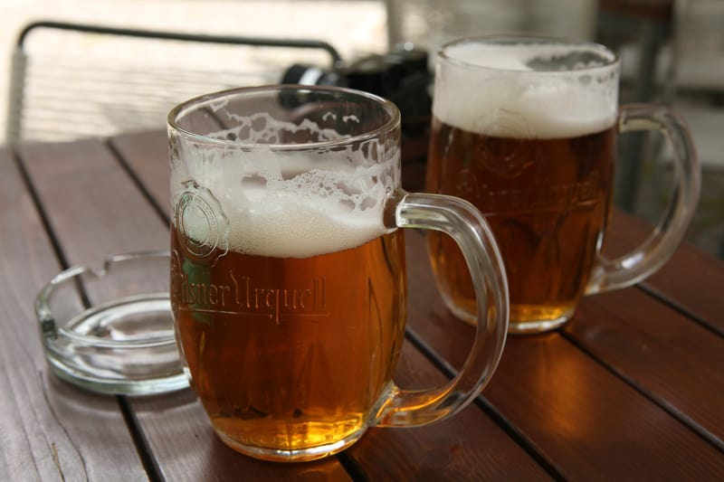 Pilsner Urquell in traditional beer mugs in Prague
