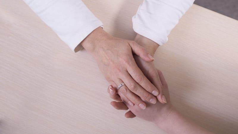 Prayer between healthcare worker and patient Image