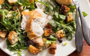 Roast chicken recipe on warm bread salad Image