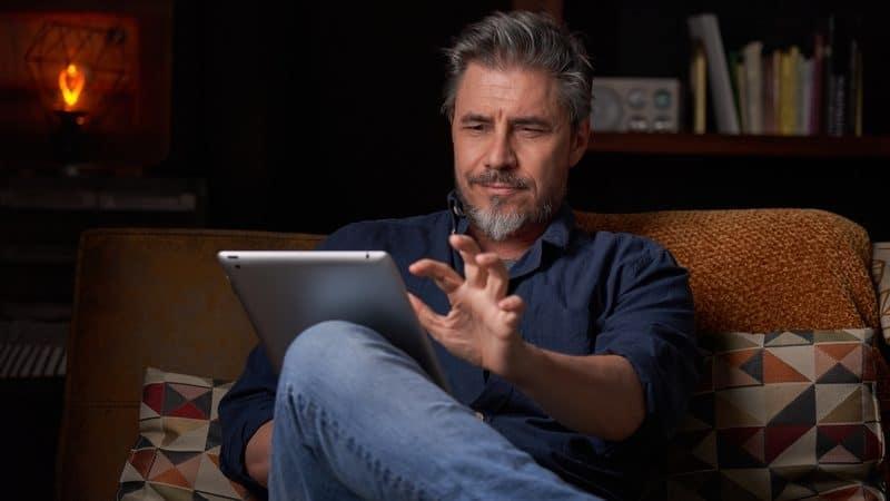 man reading tablet boomer digital edition magazines Nyul Dreamstime Image