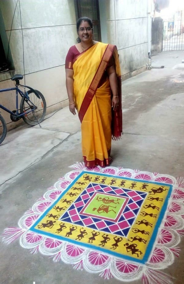 Indian woman on street with kolam and native American looking figures