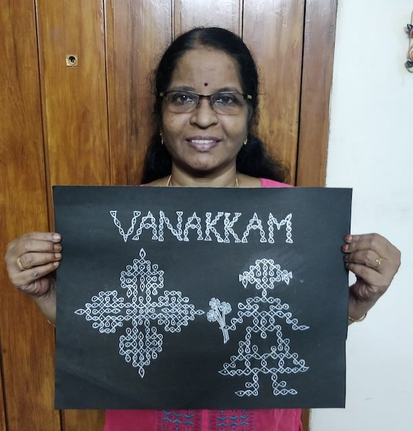 """Indian woman with kolam figures and the word """"Vanakkam,"""" a greeting"""