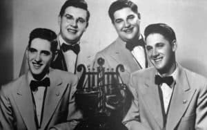 1951 quartet with trophy. Schmitt Brothers barbershop quartet Image