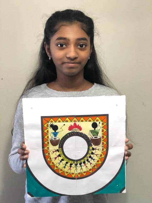 Indian girl with kolam