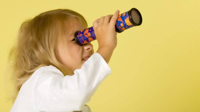 Little girl looking through a kaleidoscope at Richmond Restaurant Week Image