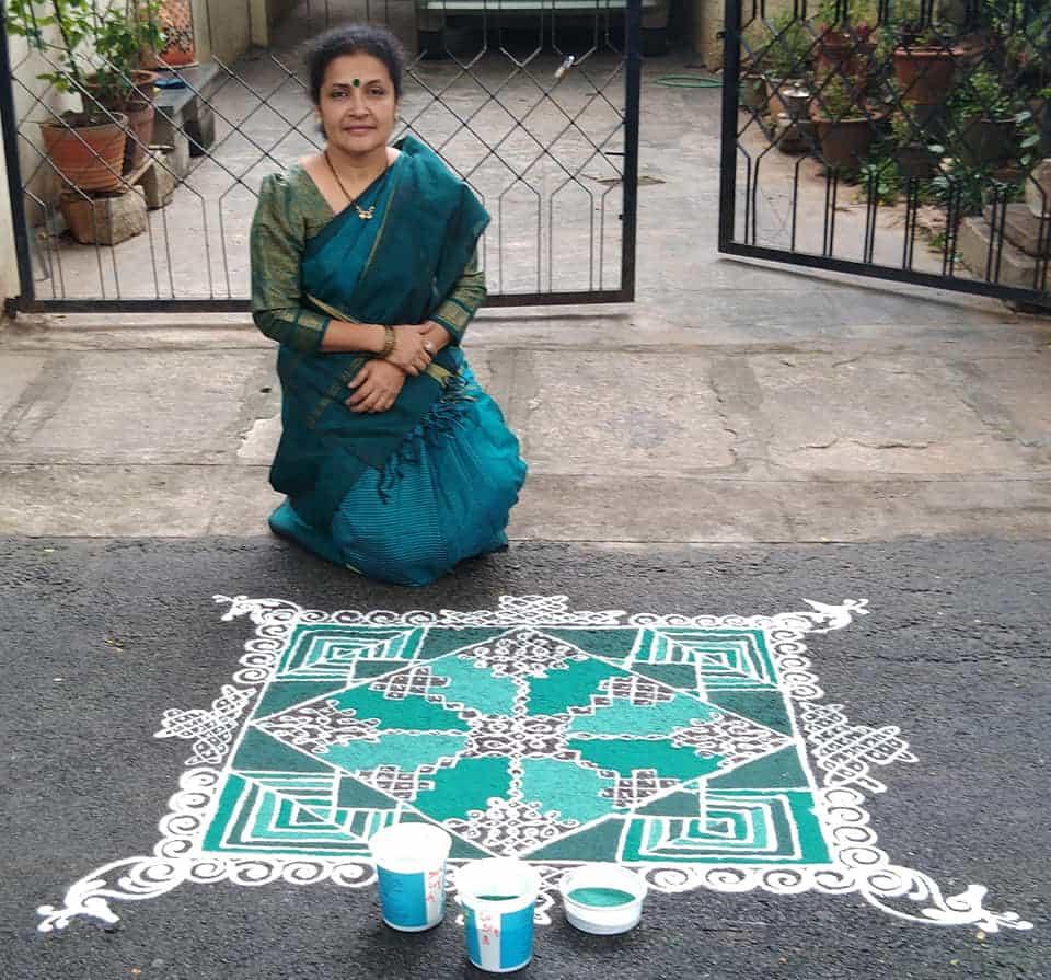 Indian woman with traditional kolam Prathima Dattatreya #1