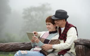 Baby boomer couple reading digital tablet Image