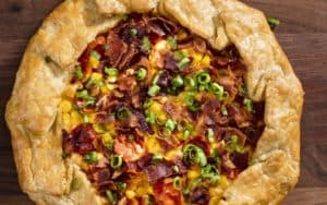Corn, tomato, and bacon galette recipe Image