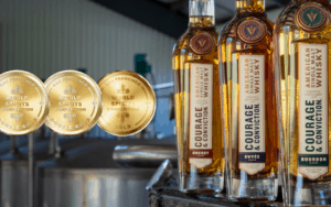 Courage & Conviction cask expressions - three bottles and three awards Image