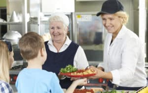 Lunch ladies at a school cafeteria Image