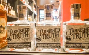 Bottles of liquor from Tarnished Truth in the historic Cavalier Hotel Image