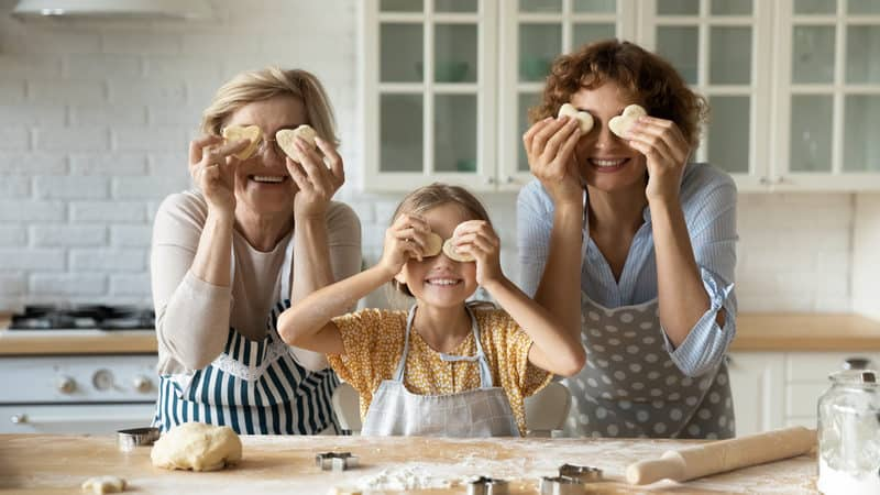 """Multigenerational family at home, Grandmom, granddaughter, and mom in the kitchen making cookies. For """"Moving Aging Parents into Your Home, Part 1."""" Photo credit: Fizkes, Dreamstime Image"""