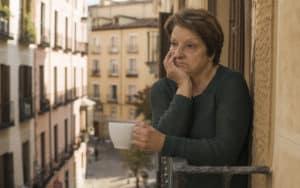Senior woman on balcony gets no appreciation Image