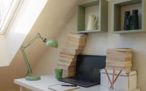 old books and a laptop in a small working nook. For Starting Again as a Writer later in life Image