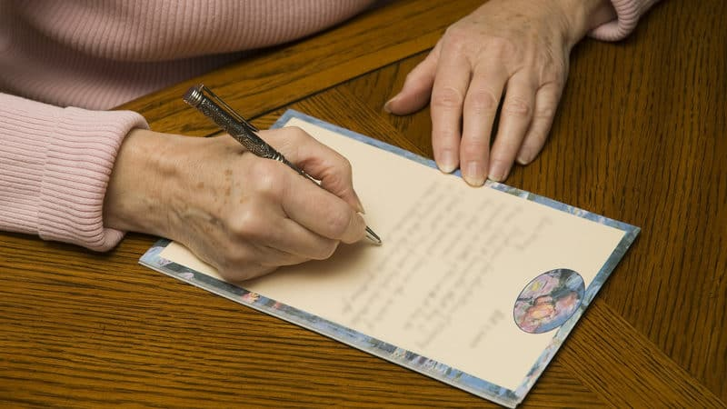 Long-distance grandma tries to write a letter Image