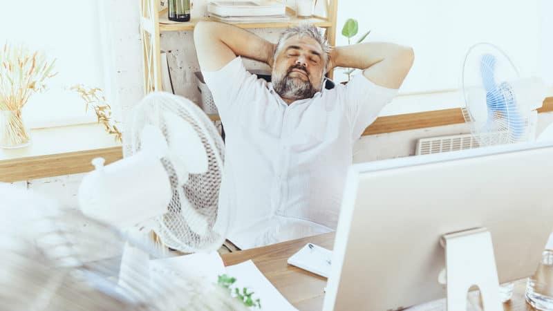 Senior man loves air conditioning Image