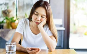 Young woman waiting for response from her biological father Image