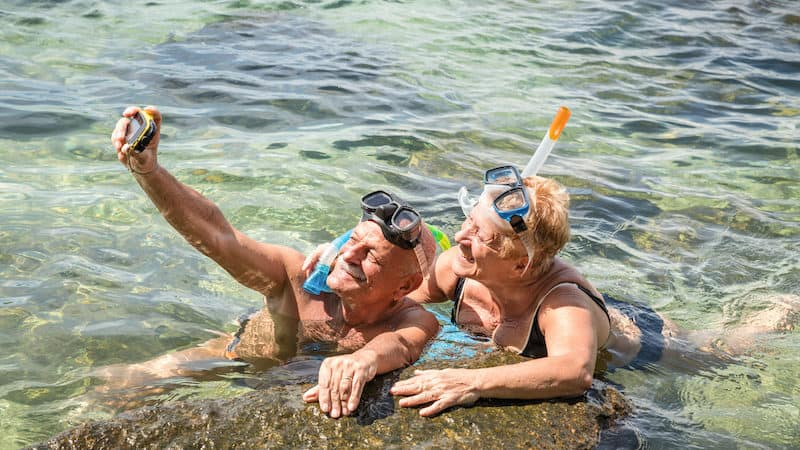 senior snorkelers. Credit: mirko vitali dreamstime. For article on Boomers Financing Post-COVID Travel Image